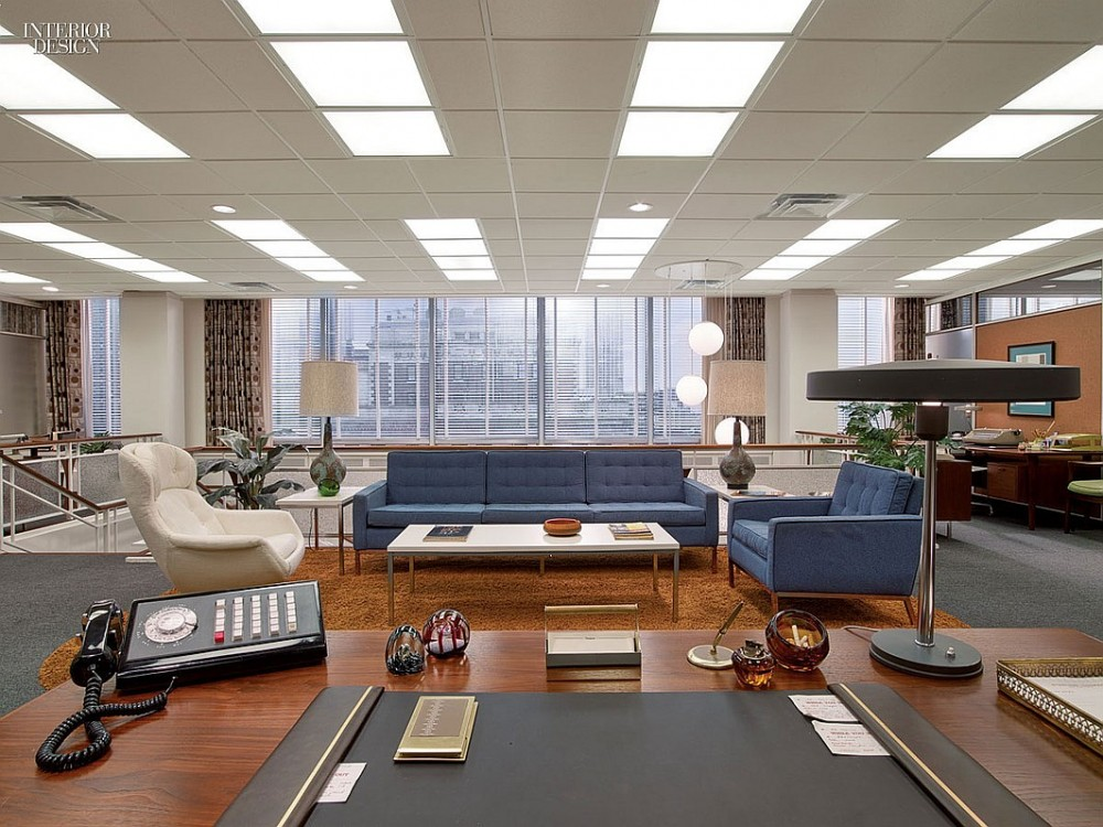 A custom Florence Knoll–style sofa and matching chair anchor the account-executive lounge at the agency.