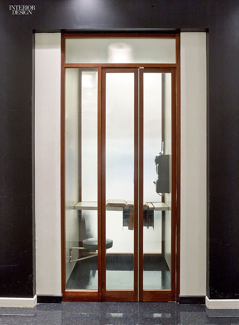 The phone booth in the elevator lobby